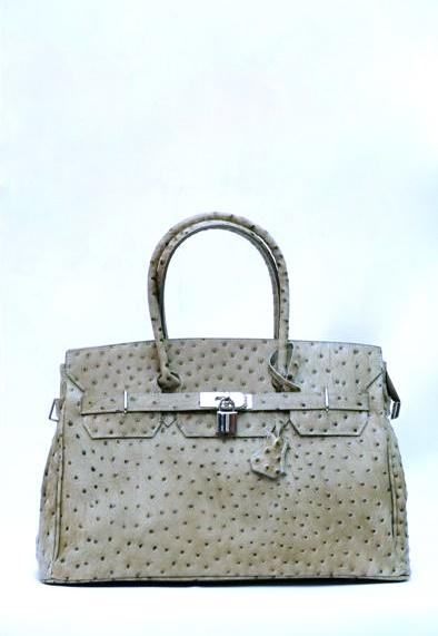 Стильная и красивая сумочка, выполненная из натуральной кожи, станет...