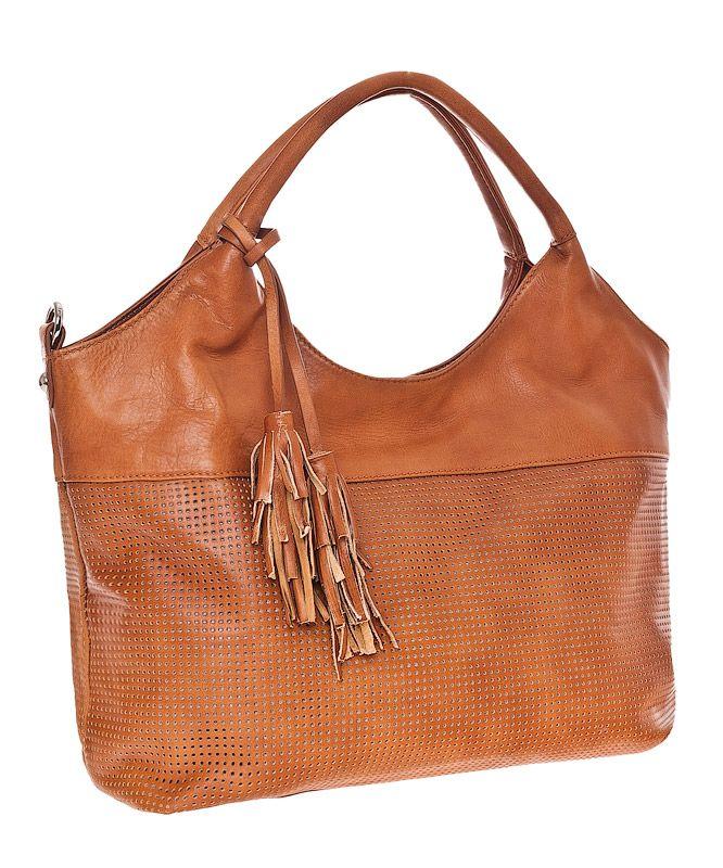 Женская сумка Palio выполнена из натуральной матовой кожи с перфорацией...